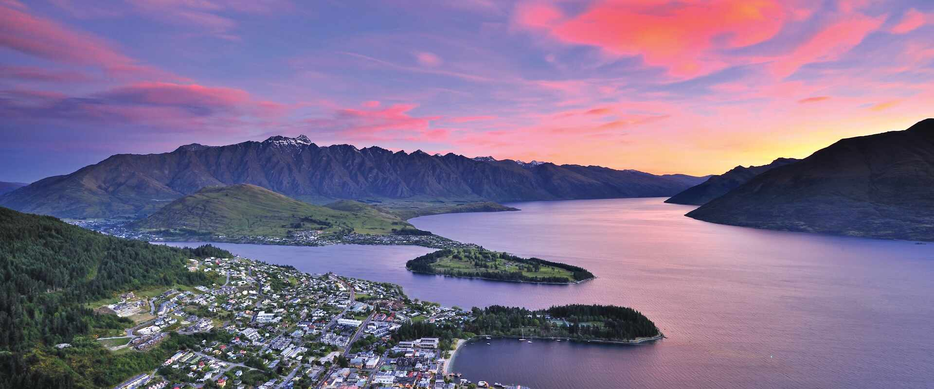 Aerial view over Lake Wakatipu and Queenstown lakesie town at sunset