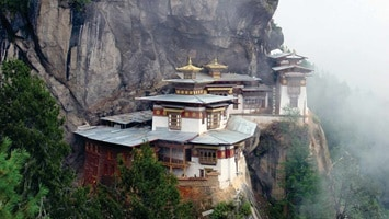 View of temple on the side of a mountain, Bhutan
