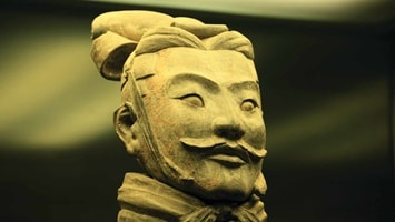 The smiling face of a Terracotta Warrior statue