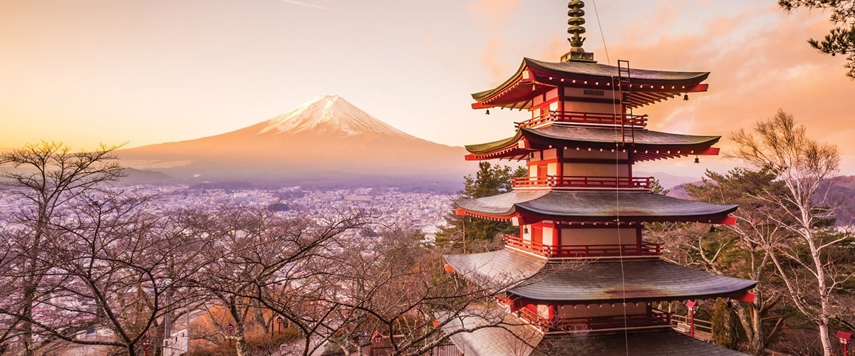 Mount Fuji and a traditional Japanese temple at dusk