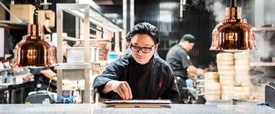 Luke Nguyen preparing a dish in the kitchen