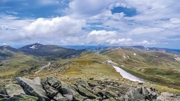 Panoramic of Mt Kosciuszko, moutains, blue skys and white clouds