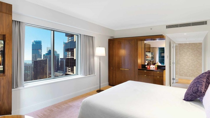Modern spacious room with large panoramic window overlooking the city skyline