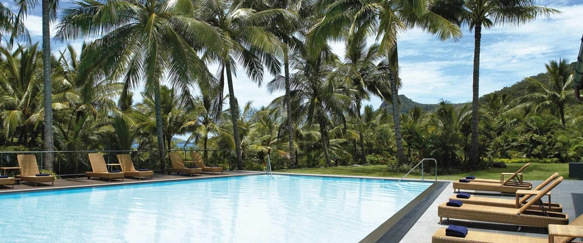 Sun lounges around the pool at Hamilton Island