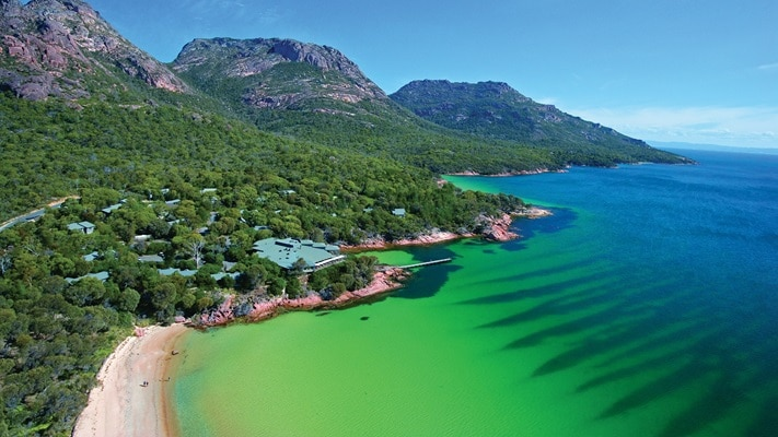 Aerial view of the Freycinet peninsula it's sandy beaches and accommodation nestled in the bushes