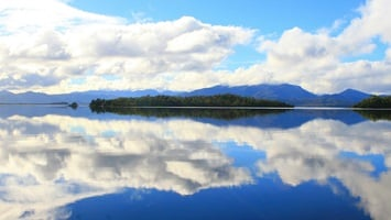 Reflection across the water of the clouds, Tasmania