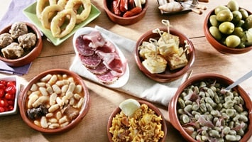 Assortment of Spanish tapas dishes.