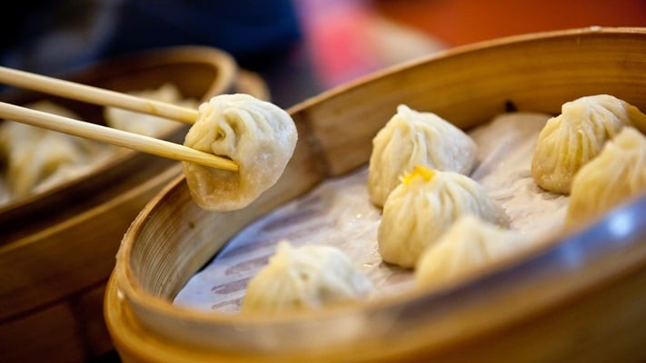 Dumplings picked up by chopstick