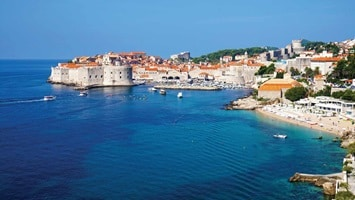 View of the ocean meeting the shoreline at the old city of Dubrovnik in Croatia.