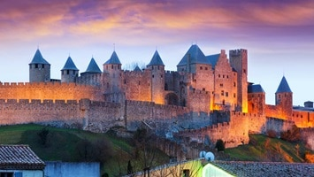 View looking fowards a huge castle during sunset, France