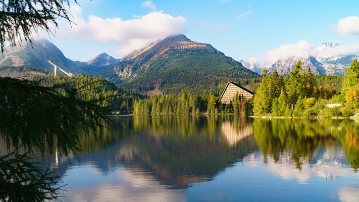 Tranquil view across lake surrounded by huge mountains, Slovakia