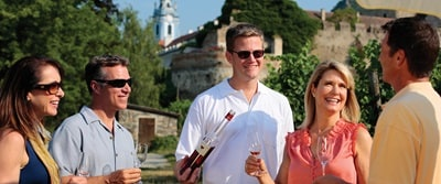 Passengers sampling wine in Austria