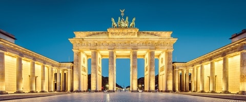Orante monument lit up at night, Germany