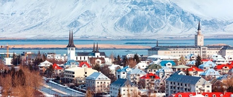 Large city with snow capped mountains in the distance, Iceland
