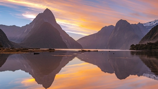 Reflection of the mountains in the pristine waters of Fiordland National Park