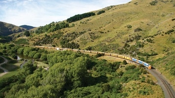 Train travelling through the countryside, New Zealand