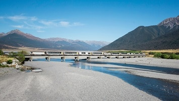 Tranzalpine train crossing a bridge over a river, New Zealand