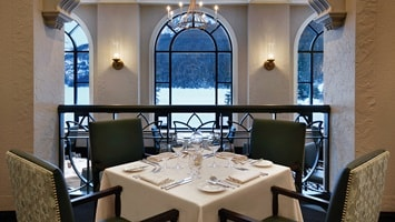 Table in restaurant with window overlooking snow outside, Canada