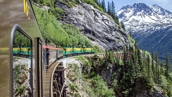 Train travelling through moutainous region, Alaska