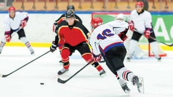 5 ice hockey players in action, Canada