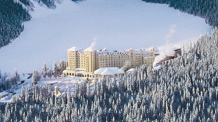Chateau Lake Louise covered in snow from the distance, Canada