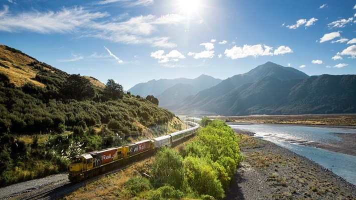 Tranz Alpine train with alps in background, South Island, New Zealand