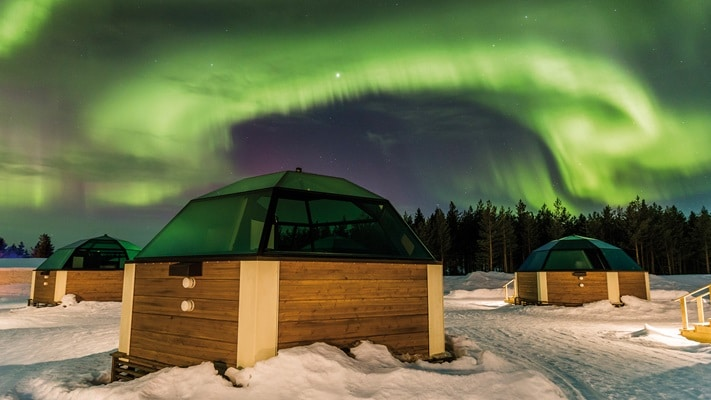 Domed glass accommodation suites under the Northern Lights