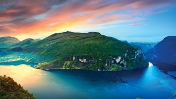 Aerial shot of Geiranger Fjord at sunset
