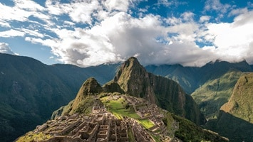 Aerial view over mountains and ancient village of Machu Picchu, Peru
