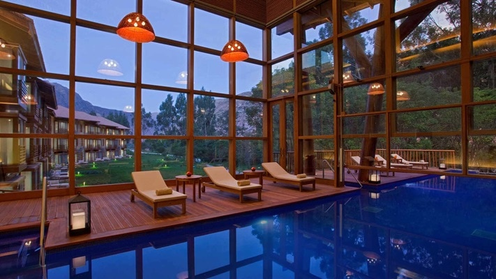 Indoor pool and lounge chairs at dusk, South America